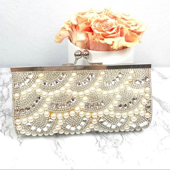 Charming Charlie Handbags - NWOT Charming Charlie Pearl and Rhinestone Clutch